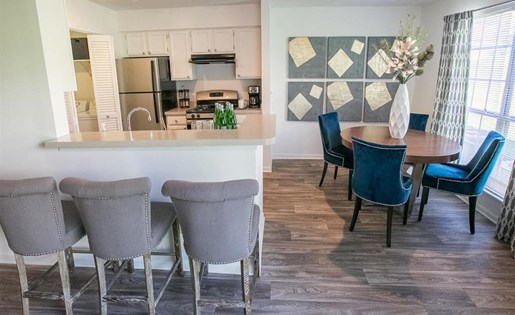 Open kitchen and dining space at Residence at Christopher Wren in Gahanna OH