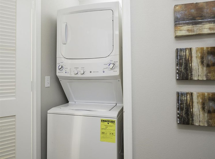 Stacked in-home washer and dryer at Talavera Apartments in Denver, CO