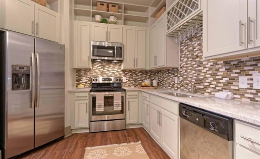 Kitchen with stainless steel appliances at 1160 Hammond Apartments in Sandy Springs, GA