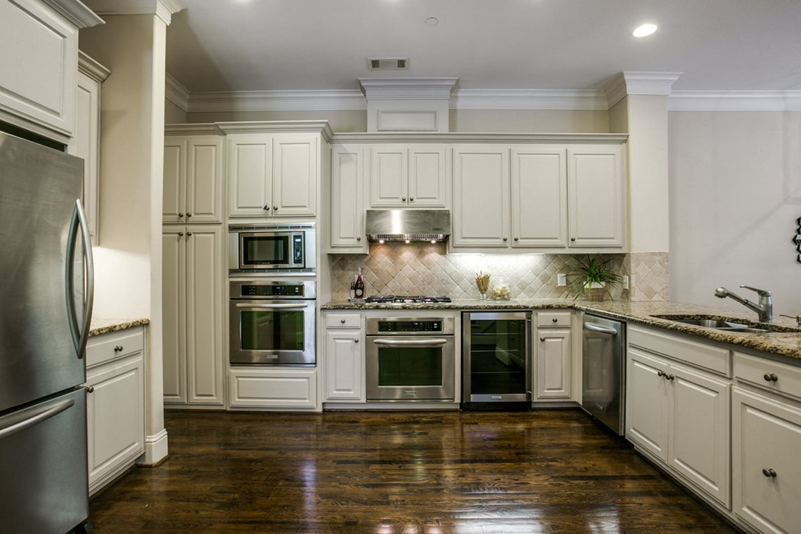 Gourmet Kitchens with Islands, Caesarstone Countertops, and Decorative Backsplash at Holland Ave Townhomes, Dallas, TX