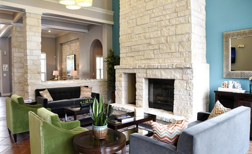 Windsor Cypress Apartments for rent in Houston, TX - living room fireplace