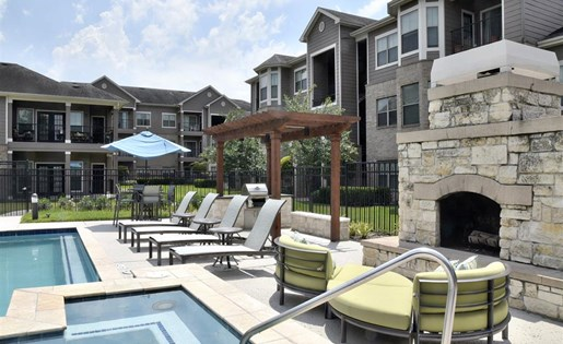 Windsor Cypress Apartments for rent in Houston, TX - outdoor pool and fireplace