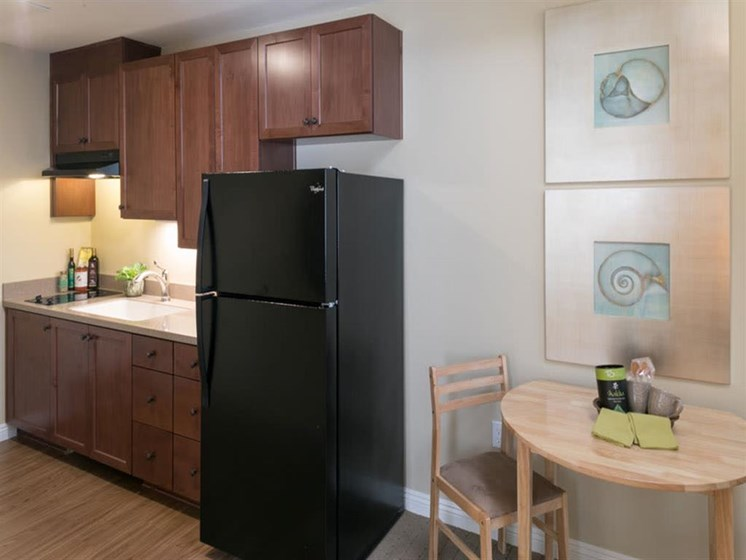 Well Equipped Kitchen And Dining at Mariposa at Ellwood Shores, California