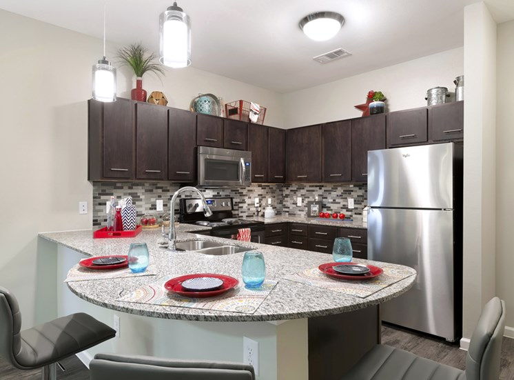 Kitchen with White Granite Countertops  at Standard at Leander Station, Leander, TX