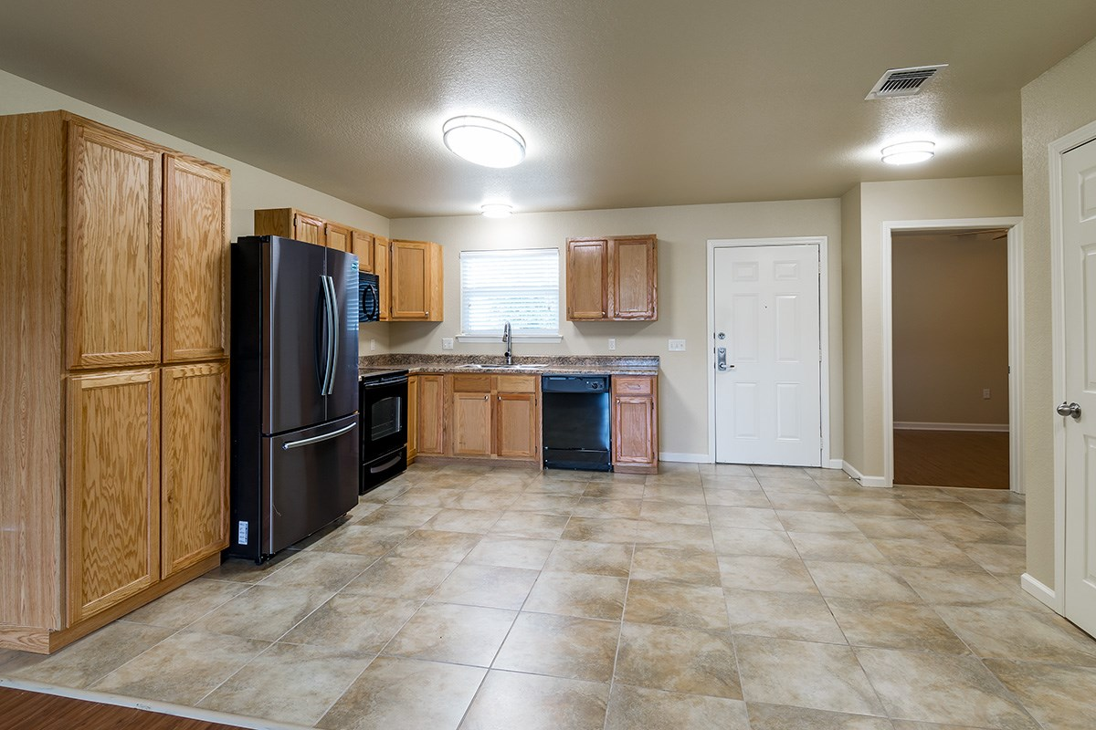 Kitchen and front door of a home at Gardens of Weatherford