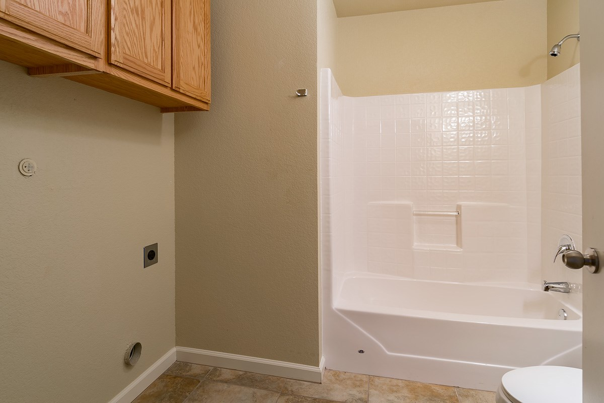 Second bathroom with hookups for full sized washer and dryer