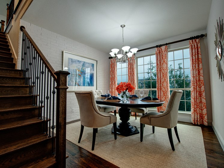 Dining Room with Floor to Ceiling Windows at Cottages at the Realm, Homes for rent in Castle Hills, Lewisville, TX