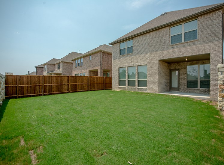 Fully Landscaped Backyards at Cottages at the Realm, Homes for rent in 3600 Windhaven Parkway, Suite 200 Lewisville, TX 75056