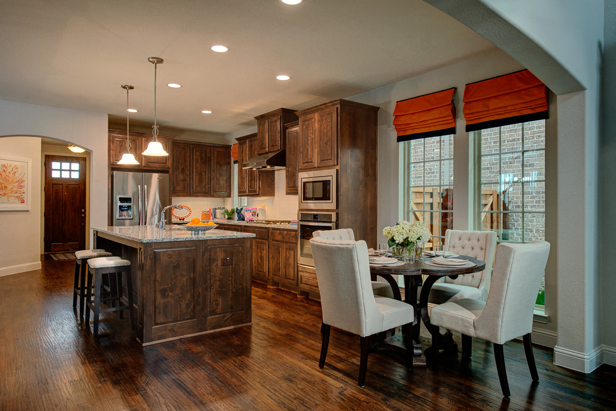 Model Kitchen with Hardwood Flooring and Dining Room