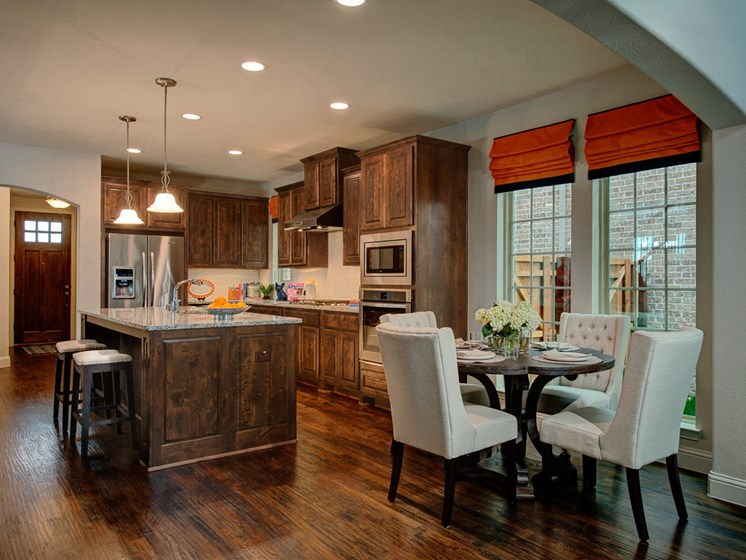 Model Kitchen with Hardwood Flooring and Dining Room at Cottages at the Realm, Homes for rent in Lewisville, TX 75056