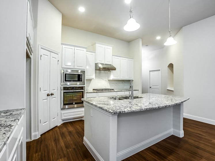 kitchen island at Cottages at the Realm, Homes for rent in Lewisville, TX