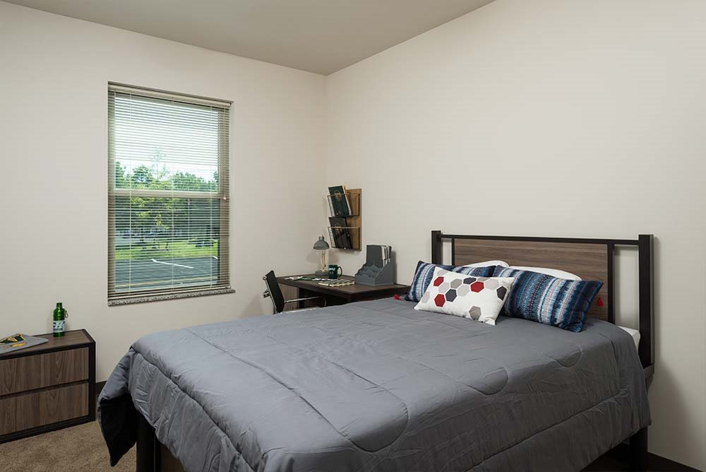 Full-size beds at College Suites at Hudson Valley, Troy, 12180