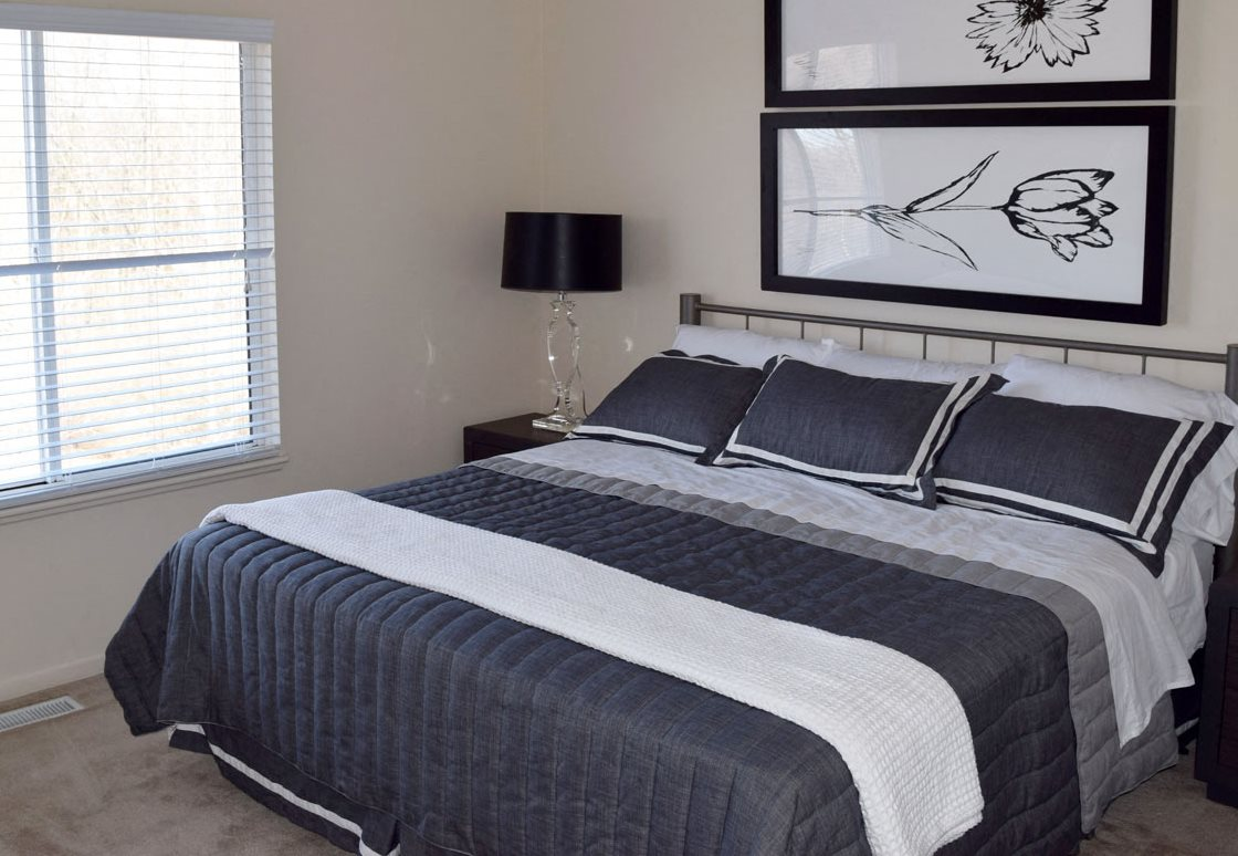 Townhome Bedroom with Vaulted Ceiling at Autumn Lakes Apartments and Townhomes in Mishawaka, Indiana 46544