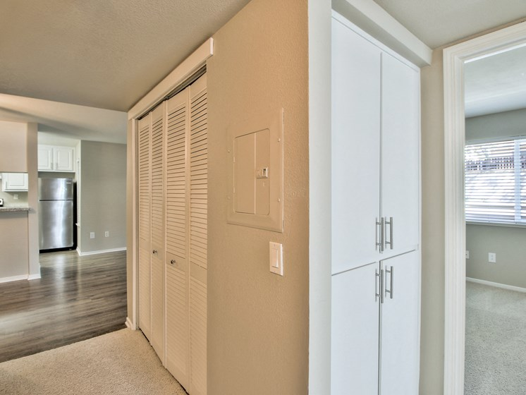 Image of carpeted hallway and storage.