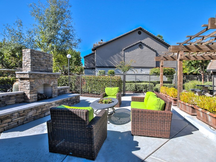 Outdoor lounge area with fire pit and seating.