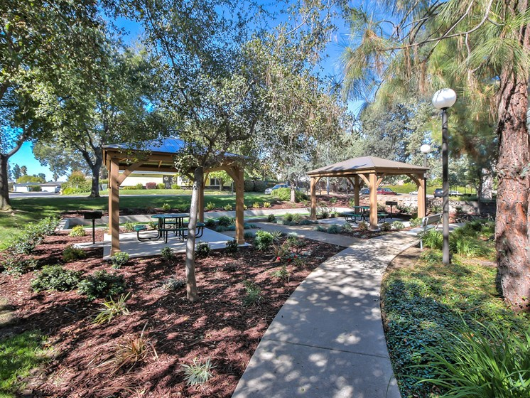 Outdoor landscaped pedestrian walkway and gazebos.