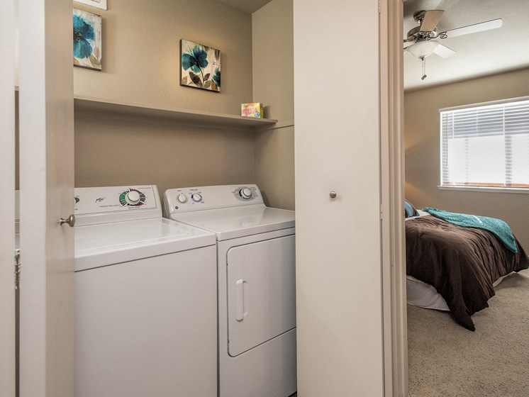 Image of in-unit laundry room with full size washer and dryer.