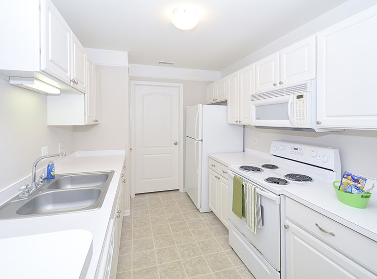 spacious kitchen extra storage large cabinets fully equipped