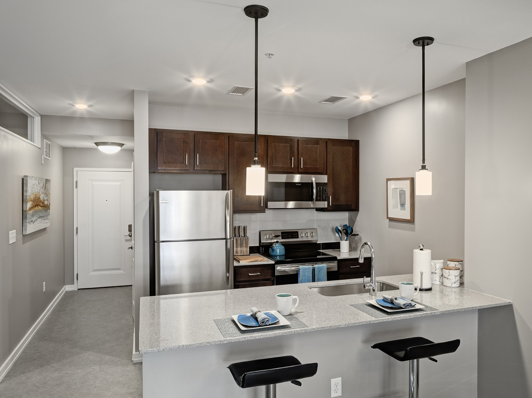 Premium Full-Size Stainless Steel Appliances and Kitchen Islands with Quartz Countertops are Perfect for Entertaining or the Casual Gourmet at The News, Troy