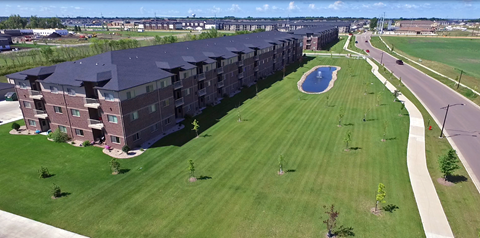 exterior, large building, grass, pond, fargo apartment