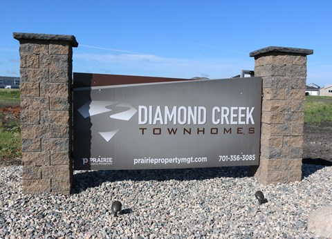exterior sign, property sign, diamond creek townhomes