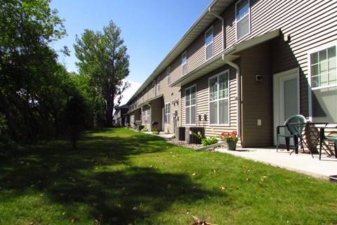 patio, backyard, matrue trees, grass, building, townhome