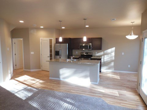 kitchen with island, dining area, unfurnished