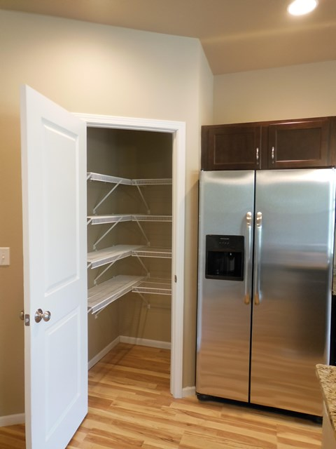 kitchen pantry, shelved, refrigerator