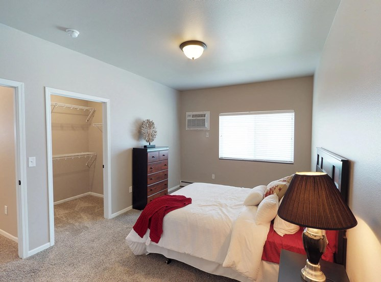 bedroom with dresser and bed, moorhead apartment