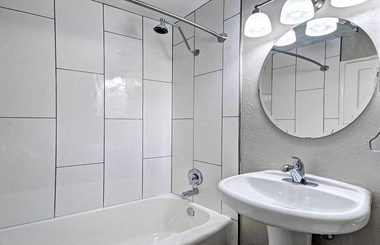 sink with mirror view for apartment bathroom
