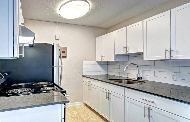 white modern cabinetry for apartment building located in seattle washington