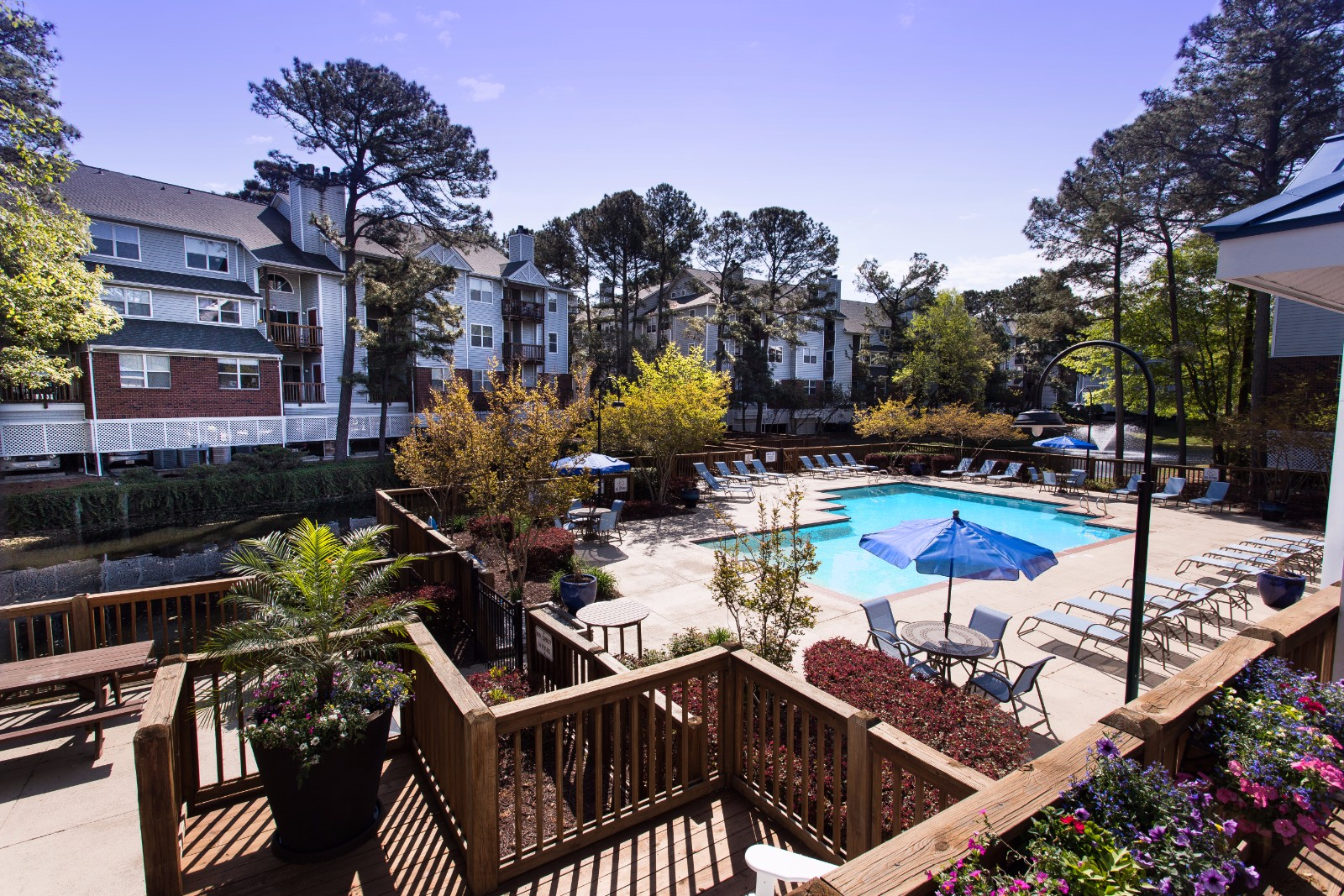 Poolside Sundeck and Entertainment Area at Marina Shores Apartment Homes, 2257 Willow Oak Circle, VA