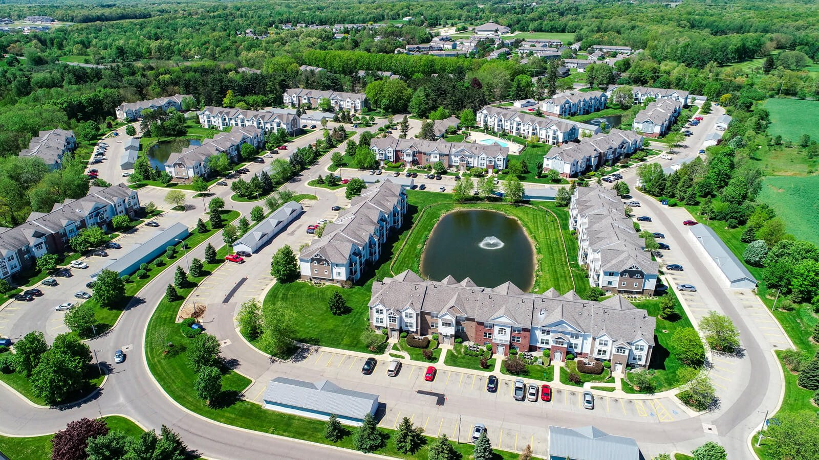 Beautiful Landscape with Lovely Wooded Views and Duck Pond at Gull Prairie/Gull Run Apartments and Townhomes, Kalamazoo, 49048