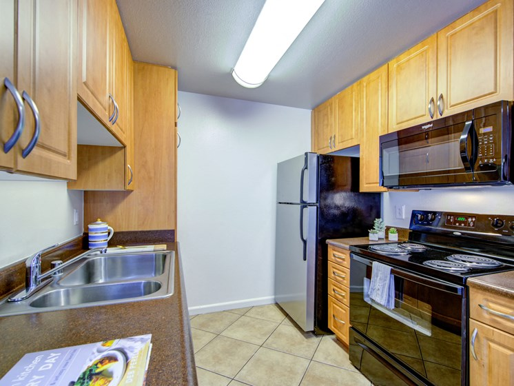 Updated kitchen with black appliances