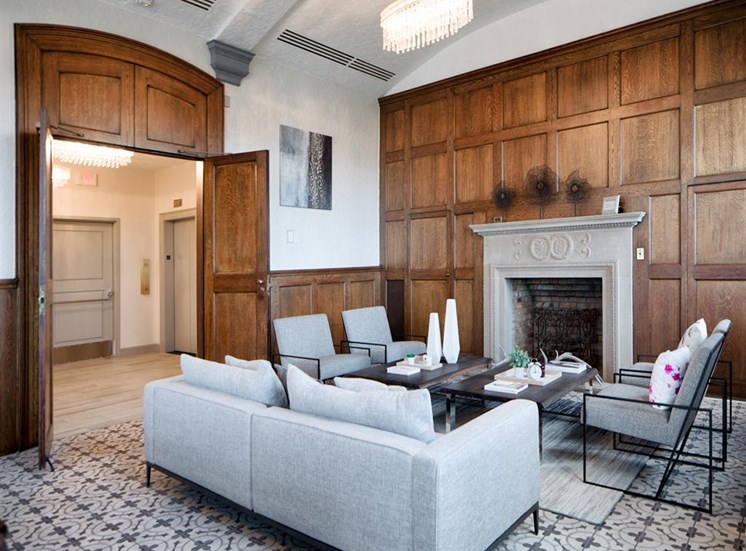image of couch seating area around fireplace in luxury apartment building