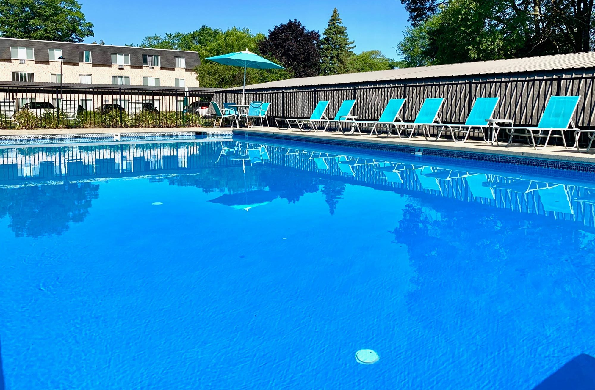 Swimming Pool and Sundeck at The Shores of Roosevelt Park Apartments in Muskegon MI