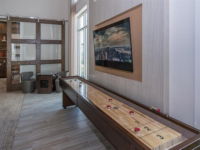 Game lounge with Shuffleboard at Windsor Republic Place, Texas