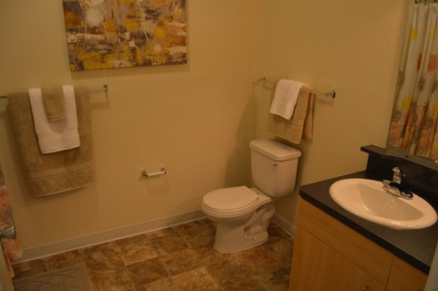 Bathroom with Tile Flooring at Lynbrook Apartment Homes and Townhomes, Nebraska, 68022