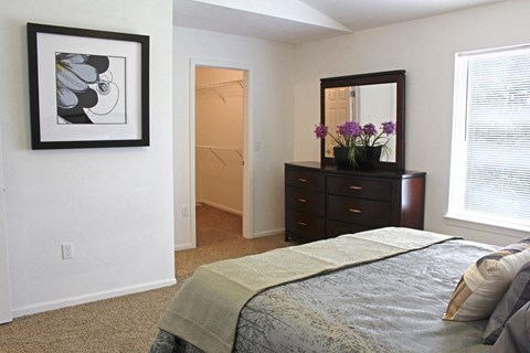 Spacious Bedroom with Walk-In Closet and Expansive Window at Lynbrook Apartment Homes and Townhomes, Elkhorn