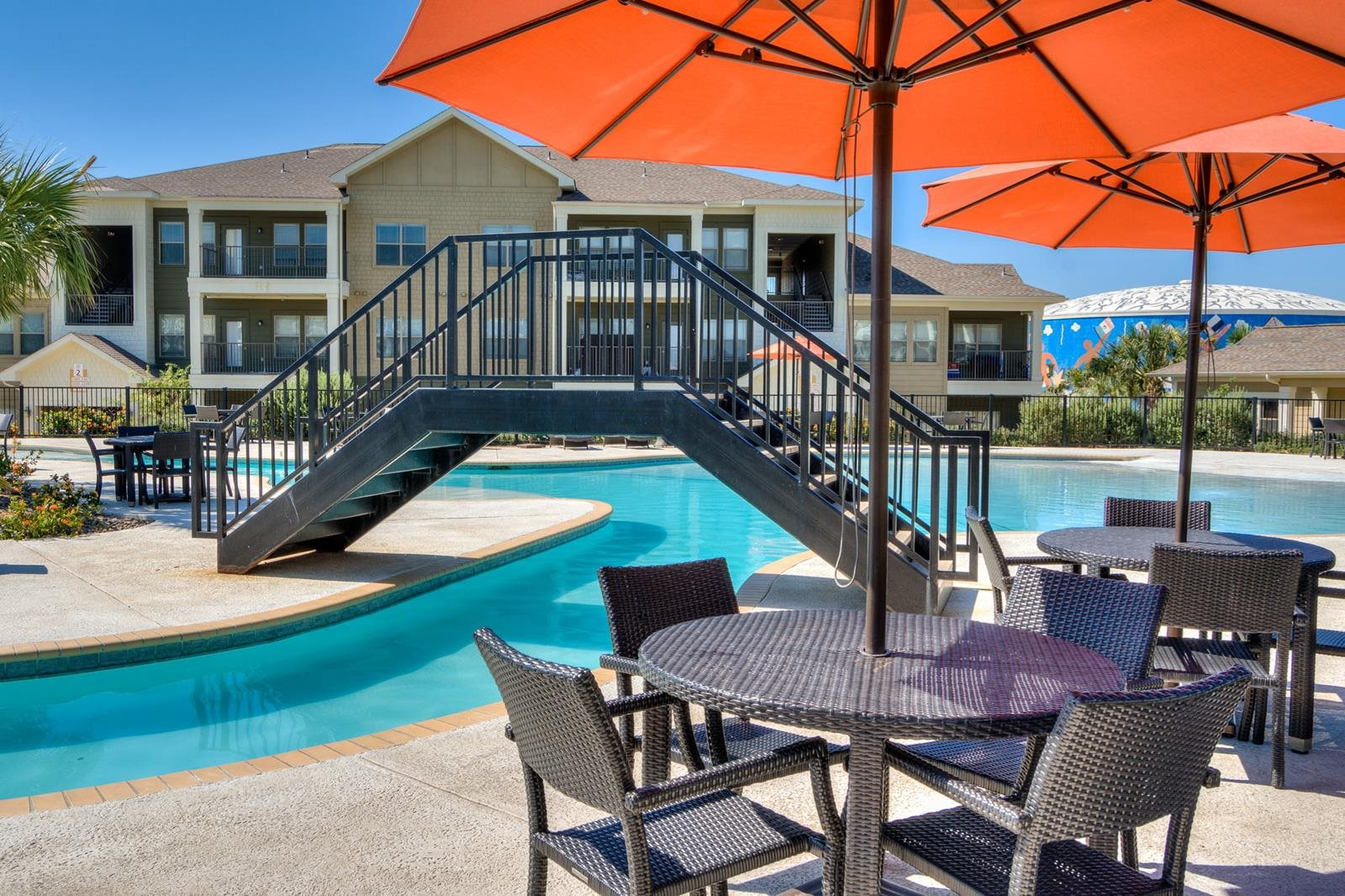 Poolside Dining Tables at La Contessa Luxury Apartments, Texas