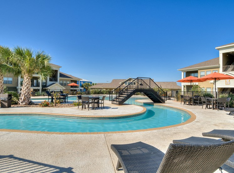 Swimming Pool with Lounge Chairs at La Contessa Luxury Apartments, Laredo,Texas