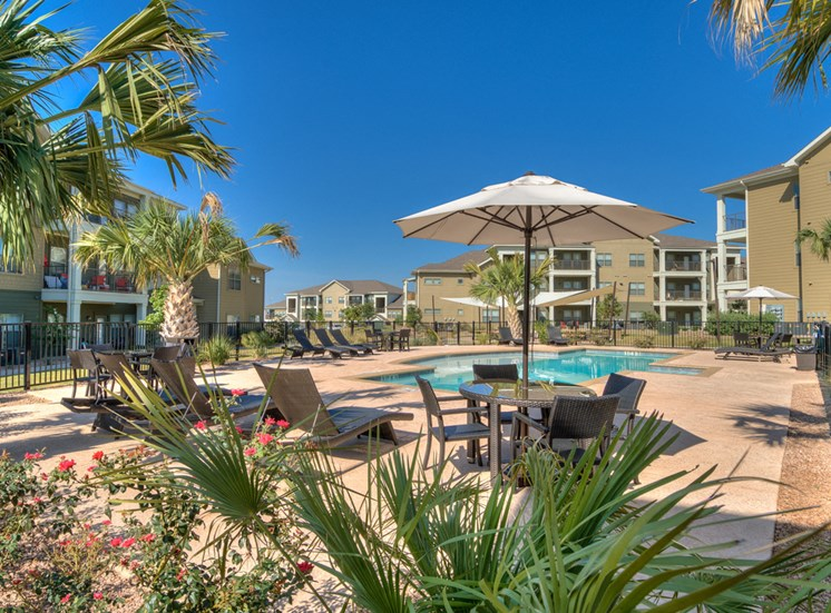 Umbrellas and Lounge Chairs by the Pool at La Contessa Luxury Apartments, Texas, 78045
