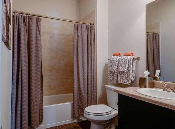 Large Soaking Tub In Master Bathroom with A Tile Surround at La Contessa Luxury Apartments, Laredo, 78045