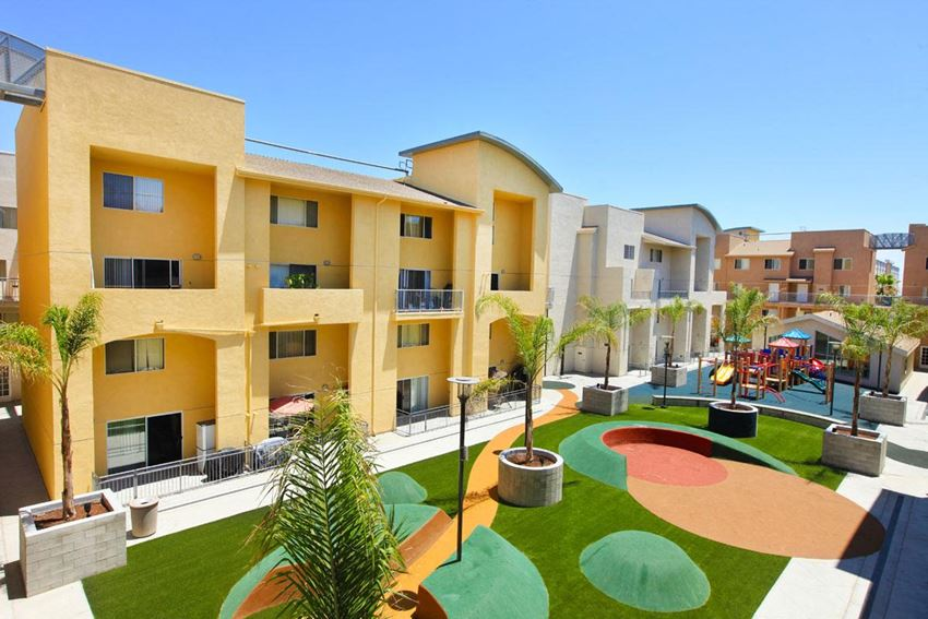 Community lawn and courtyard with yellow and light gray community exterior.