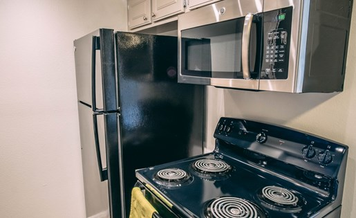 Black and silver appliances at Berkdale apartments in Riverside CA
