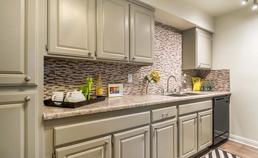 Renovated kitchen counters at Berkdale Apartments in Riverside CA