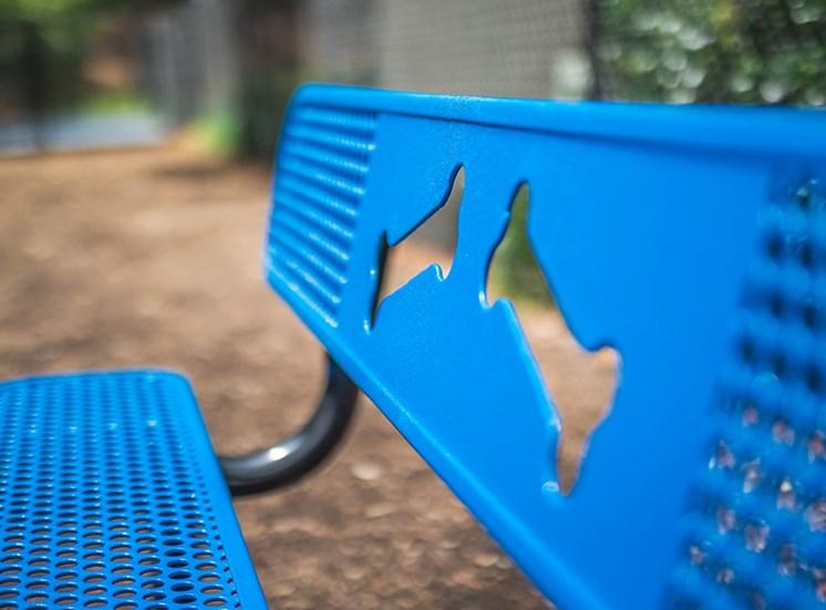 Blue bench at dog park at  Remington Place Apartments