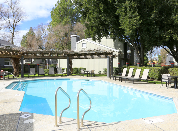 Pool with lounge chairs l Ellington Apartments in Davis CA