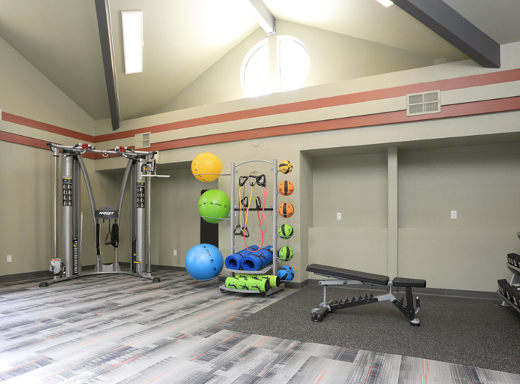 Gym with equipment l Ellington Apartments in Davis CA