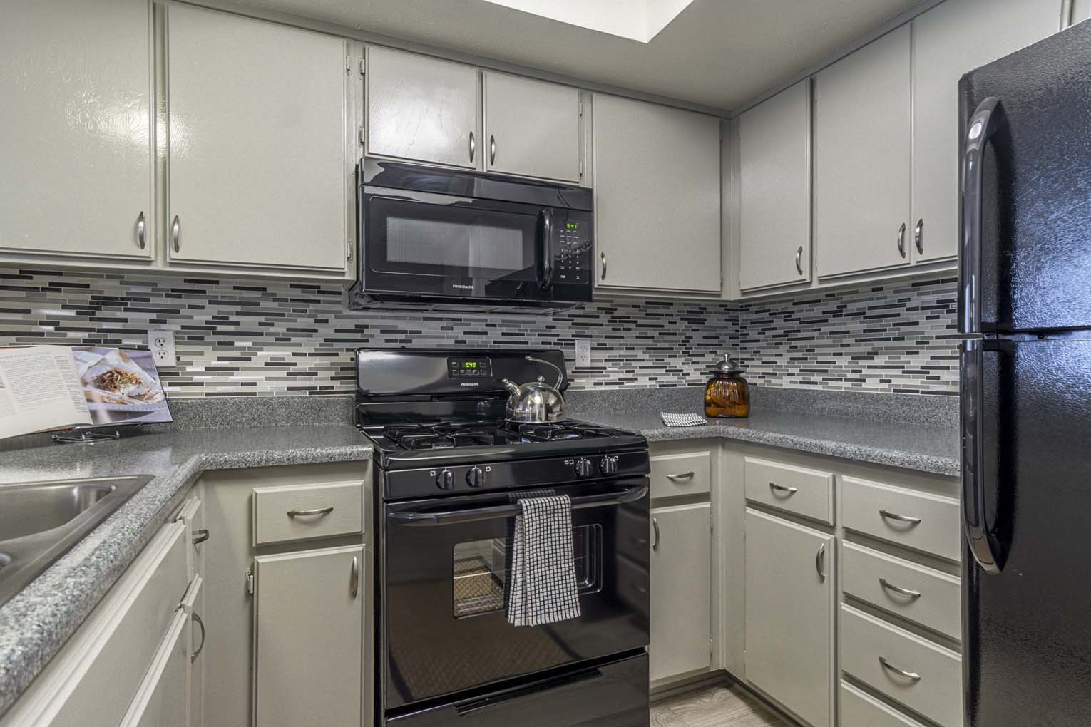 Renovated kitchen at Hensley at Corona Pointe Apartments in Corona, CA